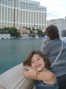 my daughter watching the fountains at the bellagio in las vegas
