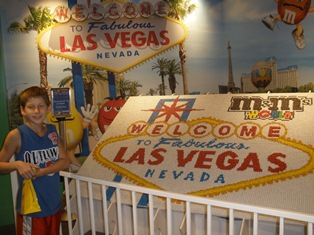 my son standing in front of a lego display in las vegas